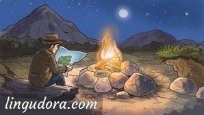 It's nighttime. A man is sitting next to a campfire on a tree trunk looking at a map. In the background a mountain and a hill is shown. The dark blue sky is filled with stars and the full moon is lighting the scene.